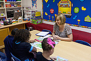 Lovington schools reading specialist Shawnlee Caballero works with students. Lea County schools are using Recovery and Reinvestement funds to pay for much needed teachers and specialists like Cabalero.