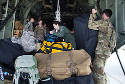 U.S. Air Force crew chief and loadmaster from the 71st Rescue squadron organize bags before securing them on a HC-130J Combat King II traveling to Texas in preparation of possible hurricane relief support August 26, 2017, at Moody Air Force Base, Ga. The 23d Wing launched HC-130J Combat King IIs, HH-60G Pavehawks, aircrew and other support personnel to preposition aircraft and airmen, if tasked to support Hurricane Harvey relief operations. (U.S. Air Force photo by Staff Sgt. Eric Summers Jr.)