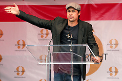 Dec 03 2007. New Orleans, Louisiana. Lower 9th Ward.<br /> Brad Pitt revisits the Lower 9th ward, devastated by Hurricane Katrina to present 'Make it Right' where architects' designs are unveiled to the public. Brad on stage gives a passionate  presentation to the press and public.<br /> Photo credit; Charlie Varley.