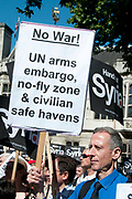 Demonstration against any intervention in Syria called by Stop the War and CND, August 30th 2013, Central London. Peter Tatchell, political activist, holds placards saying 'No war, UN arms embargo, no-fly zone and civilian safe havens' .