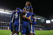 Diego Costa of Chelsea  © celebrates with his teammates after scoring his sides 4th goal to make it 4-2 . Premier league match, Chelsea v Stoke city at Stamford Bridge in London on Saturday 31st December 2016.<br /> pic by John Patrick Fletcher, Andrew Orchard sports photography.