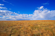 Clouds in blue sky over Buffalo Gap National Grassland, South Dakota, USA