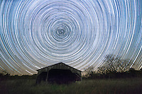 Stars appear to rotate above this abandoned barn in 3 hours time. In reality it is the stars that are stationary and the earth that is rotating. In 23 hours and 56 minutes, the stars make one counterclockwise rotation of 360 degrees. This 4 minute difference is what causes the stars to change position from night to night, and the constellations to change from season to season. Earth's northern axis happens to be pointed at Polaris, or the North Star. It hardly moves at all in the course of a night. For thousands of years people have been using Polaris to navigate. It not only tells you which way is north, but it also tells you your latitude. In this case the North Star was 40 degrees above the horizon. Those in the southern hemisphere do not have such a star to guide them.<br /> I found this old barn in Jim Edgar State Park a couple nights ago.