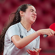 TOKYO, JAPAN - JULY 24: Twelve year old Hend Zaza of Syria, the youngest competitor in the Olympic Games reacts during her loss against Jia Liu of Austria in the Women's Singles  Preliminary Round in the Tokyo Metropolitan Gymnasium at the Tokyo 2020 Summer Olympic Games  on July 24, 2021 in Tokyo, Japan. (Photo by Tim Clayton/Corbis via Getty Images)
