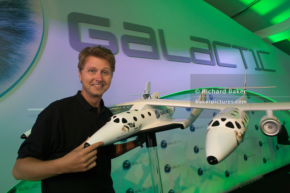 Virgin Galactic space tourist Per Wimmer with WhiteKnightTwo space vehicle and SpaceShipTwo in the middle at PR event