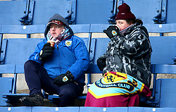 Burnley Fans wrap up warm in the stands before the Premier League match at Turf Moor, Burnley.