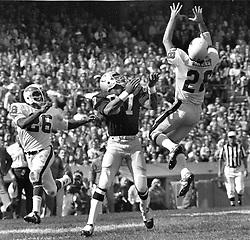 Philadelphia Eagle #28 Bill Bradley intercept Oakland Raider pass intended for Ray Chester. #26 Al Nelson.<br />(1971 photo/RonRiesterer)