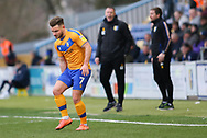 Mansfield Town midfielder Alex MacDonald (7) pulls up with an injury  during the EFL Sky Bet League 2 match between Mansfield Town and Carlisle United at the One Call Stadium, Mansfield, England on 1 February 2020.