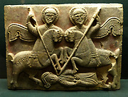 Limestone slab from the exterior decor of a church in Amaseia depicting two military saints, named by inscriptions and Theodore and George thrusting their spears into the foe. 13th century