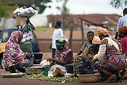 Women selling limes on the roadside in Tamale, northern Ghana, on Sunday June 3, 2007.