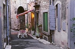 July 21, 2019 - Tables And Chairs On Small Street, Grignan, Provence, France (Credit Image: © Bilderbuch/Design Pics via ZUMA Wire)