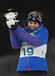 PYEONGCHANG, Feb. 12, 2018  France's Anais Bescond clebrates during the venue ceremony of women's 10km pursuit event of biathlon at the 2018 PyeongChang Winter Olympic Games at Alpensia Biathlon Centre in PyeongChang, South Korea, on Feb. 12, 2018. Bescond won a bronze in a time of 31:04.9. (Credit Image: © Wang Haofei/Xinhua via ZUMA Wire)