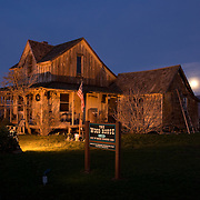 During dusk, a full moon rises above the Cascade Mountain Range.  The Wood House, was built in 1870 by Civil War veteran Martin Sylvester Wood.  The house stands in Eagle Point, Oregon  along Hwy 62 which leads from Medford to Crater Lake National Park. The house is one of the oldest in southern Oregon and is preserved by the Wood House Preservation Group.