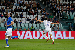 Andros Townsend of England wheels away to celebrate after he scores a goal to make it 1-1 - Photo mandatory by-line: Rogan Thomson/JMP - 07966 386802 - 31/03/2015 - SPORT - FOOTBALL - Turin, Italy - Juventus Stadium - Italy v England - FIFA International Friendly Match.