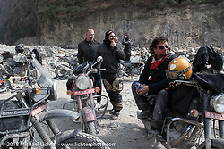Regrouping after a water crossing on  Day-7 of our Himalayan Heroes adventure riding from Tatopani to Pokhara, Nepal. Monday, November 12, 2018. Photography ©2018 Michael Lichter.