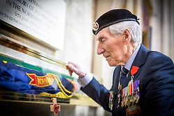© Licensed to London News Pictures. 14/03/2017. York UK. 92 year old Ken Smith places the Normandy Veterans branch standard in it's final resting place at York Minster this morning. The last four members of the York branch of the Normandy Veterans Association have attended a service today at York minster as part of a special memorial to lay-up their standard in it's final resting place in the minster & to all who served in the Normandy campaign in 1944. The standard has been placed in it's case in the North Transept of the minster by Kenneth Smith who was part of the Duke of Cornwall's Light Infantry and landed in Normandy on D-Day June 1944 aged just 19 years old. Mr Smith was joined by the remaining three members of the York branch - Ken Cooke, 91, Albert Barritt, 91 and George Meredith, 92 - and their families for the service. All four veterans were awarded the Legion d'Honneur, France's highest military honour, in May 2016. Photo credit: Andrew McCaren/LNP