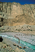 Bactrian camel caravan crosses river, Aghil range, Chongtar expedition 1994, Karakoram mtns, far western China, Central Asia.