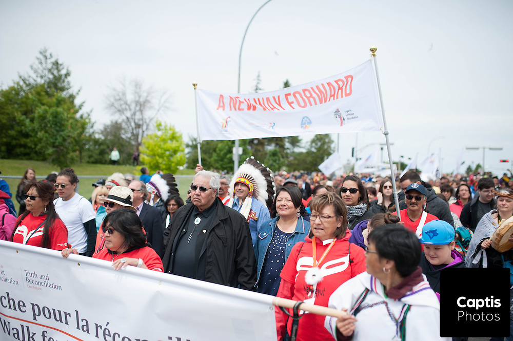 """Around 7,000 to 10,000 people walked from a Gatineau school to Ottawa City Hall in an effort to """"transform and renew"""" the relationship between aboriginal people and other Canadians as the Truth and Reconciliation Commission of Canada prepares to release its final report on Tuesday."""
