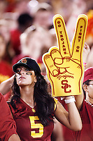 1 September 2007: Fan wearing Reggie Bush shirt and fight on finger in the stands.  USC Trojans college football team defeated the Idaho Vandals 38-10 at the Los Angeles Memorial Coliseum in CA.  NCAA Pac-10 #1 ranked team first game of the season.