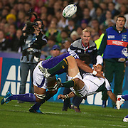 Fourie Du Preez, South Africa, is tackled by Taiasina Tuifua, Samoa, during the South Africa V Samoa, Pool D match during the IRB Rugby World Cup tournament. North Harbour Stadium, Auckland, New Zealand, 30th September 2011. Photo Tim Clayton...