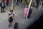 A man wearing a patriotic Union Jack suit waits for the next bus along with other commuters at Elephant & Castle in Southwark, south London, on 10th May 2019, in London, England.