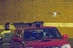 © Licensed to London News Pictures . 15/09/2015 . Manchester , UK . A drone , operated by Greater Manchester Fire and Rescue and equipped with thermal imaging systems , is used to find prison protester Stuart Horner amongst the rooftops of HMP Manchester , shortly before dawn this morning (15th September 2015) . Photo credit: Joel Goodman/LNP