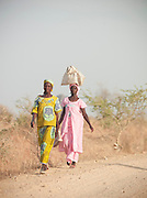 Local women walk to market in the village of Rhumsiki in the north of Cameroon