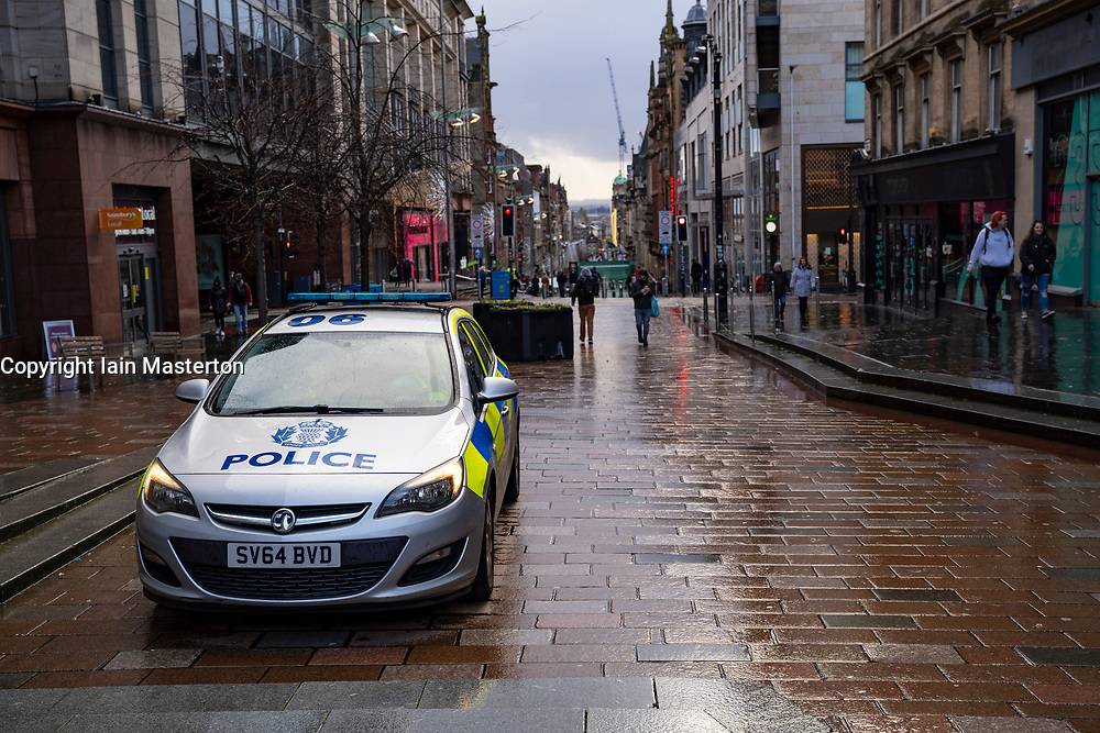 Glasgow, Scotland, UK. 21 November 2020. Views of Saturday afternoon in Glasgow city centre on first day of level 4 lockdown. Non essential shops and businesses have closed. And streets are very quiet. Pictured; Police car Parked on Buchanan Street . .Iain Masterton/Alamy Live News