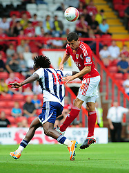 Bristol City's James Wilson wins the high ball against West Bromwich Albion's Somen Tchoyi  - Photo mandatory by-line: Joseph Meredith / JMPUK - 30/07/2011 - SPORT - FOOTBALL - Championship - Bristol City v West Bromwich Albion - Ashton Gate Stadium, Bristol, England