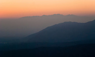 The haze and smog of a summer afternoon in the Los Angeles valley basin creates a diffused pastel sunset effect