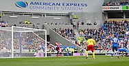 Watford Troy Deeney scores the opening goal during the Sky Bet Championship match between Brighton and Hove Albion and Watford at the American Express Community Stadium, Brighton and Hove, England on 25 April 2015. Photo by Phil Duncan.