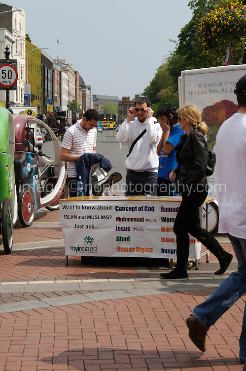 Grafton Street, Dublin, Ireland. Information table set up by 'Muslim Youth Ireland' in Dublin city centre.
