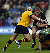 Northampton, Northamptonshire, 2nd October 2004 Northampton Saints vs London Wasps, Zurich Premiership Rugby, Franklyn Gardens, [Mandatory Credit: Peter Spurrier/Intersport Images],<br /> Saints Darren Fox, breaking with the ball is tackled by Phil Greening.<br /> email images@intersport-images.com