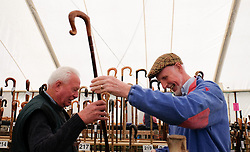 © Licensed to London News Pictures.26/08/15<br /> Egton, UK. <br /> <br /> Colin Gray (L) and Stewart Elston admire walking sticks at the 126th Egton Show in North Yorkshire. <br /> <br /> Egton is one of the largest village shows in the country and is run by a band of voluntary helpers. <br /> <br /> This year the event featured wrought iron and farrier displays, a farmers market, plus horse, cattle, sheep, goat, ferret, fur and feather classes. There was also bee keeping, produce and handicrafts on display.<br /> <br /> Photo credit : Ian Forsyth/LNP