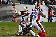 PHILADELPHIA - DECEMBER 30: Darren Howard #90 of the Philadelphia Eagles brings quarterback Trent Edwards #5 of the Buffalo Bills down during the game against the Buffalo Bills on December 30, 2007 at Lincoln Financial Field in Philadelphia, Pennsylvania. The Eagles won 17-9.