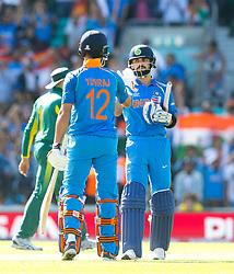 Virat Kohli (capt.) of India celebrates an 8 wicket victory with Yuvraj Singh of Indiaa (L)