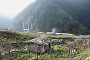 Early morning in the remote and roadless Brokpa village of Merak in Eastern Bhutan. Thriving on rearing yaks and sheep, the semi-nomadic Brokpa have maintained many of their unique traditions and customs. In summer they move to the pastures with their yaks and sheep and in winter they return to live in their houses, normally built of stones with small ventilation to protect from the piercing cold weather.