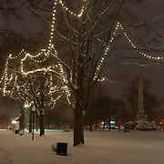 The Upper Common in Wakefield, MA is snowcovered and illuminated with Christmas lights