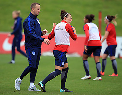 England Women's Lucy Bronze appears to shrug off manager Mark Sampson (left) during the training session at St George's Park, Burton.