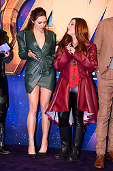 Elizabeth Olsen poses with a Marvel cosplayer attending the Avengers: Infinity War UK Fan Event held at Television Studios in White City, London.