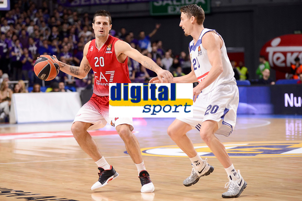 Real Madrid's Jaycee Carroll and EA7 Emporio Armani Milan's Andrea Cinciarini during Turkish Airlines Euroleage match between Real Madrid and EA7 Emporio Armani Milan at Wizink Center in Madrid, Spain. January 27, 2017. (ALTERPHOTOS/BorjaB.Hojas)