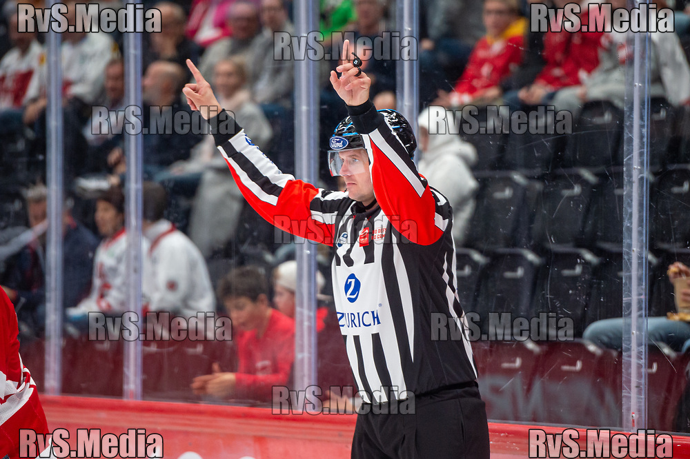 LAUSANNE, SWITZERLAND - OCTOBER 01: Referee signals the video consultation for previous goal situation during the Swiss National League game between Lausanne HC and ZSC Lions at Vaudoise Arena on October 1, 2021 in Lausanne, Switzerland. (Photo by Monika Majer/RvS.Media)