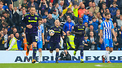 Everton's Wayne Rooney celebrates scoring his side's first goal of the game from the penalty spot during the Premier League match at the AMEX Stadium, Brighton.