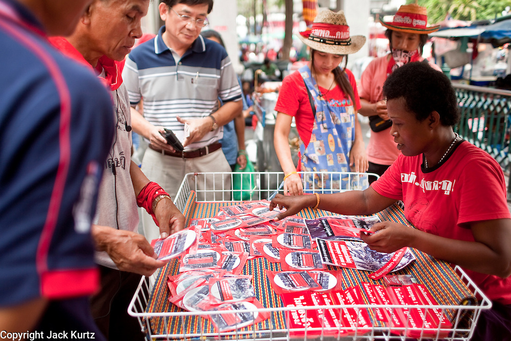 18 APRIL 2010 -- BANGKOK, THAILAND: DVDs of the violence against Red Shirts is a big seller at souvenir stands around the protest. The Red Shirts protest in the Ratchaprasong Shopping district, home to Bangkok's most upscale malls, is costing the Thai economy millions of Baht per day because the malls and most of the restaurants are closed and tourists are staying away from the area. But that hasn't stopped the Red Shirts who have brought their own economy with them. There are Red Shirt restaurants, food stands, souvenir vendors and more, creating a micro economy for Red Shirts in the area.  The Red Shirts continue to occupy Ratchaprasong Intersection an the high end shopping district of Bangkok. They are calling for Thai Prime Minister Abhisit Vejjajiva to step down and dissolve the parliament. Most of the Red Shirts support ousted former Prime Minister Thaksin Shinawatra.   PHOTO BY JACK KURTZ