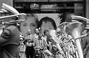 Photography of Sydney by Paul Green, Anzac Day Parade George St Sydney,Black and White, Brass band and poster in background,