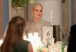 Crown Princess Mette Marit of Norway during dinner at the Royal Palace also attended by the Duke and Duchess of Cambridge at the end of the third day of their tour of Scandinavia.