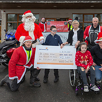 Ava Fallon from Bunratty and Michéal Fethery from Ennis with Moira Lawlor of St Clares School with Members of the West Coast Motorcycle Club who raised €2,460
