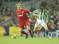 Photo: Aidan Ellis.<br /> Liverpool v Real Betis. UEFA Champions League.<br /> 23/11/2005.<br /> Liverpool's Boudewijn Zenden battles with Betis Sanchez Joachim