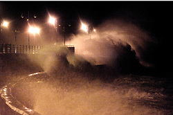 © Licensed to London News Pictures. 8/02/2016. Porthcawl, Bridgend, Wales, UK. Gale force winds and huge waves pound the seafront at high tide this morning. Storm Imogen batters the small Welsh seaside resort of Porthcawl in the county borough of Bridgend on the South coast of Wales, UK. Photo credit: Graham M. Lawrence/LNP