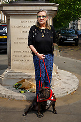 © Licensed to London News Pictures. 07/06/2016. London, UK. Star Wars actress CARRIE FISHER protests against China's Yulin dog meat festival and supports handing in an 11 million-signature petition against the festival, outside Chinese Embassy in London on Tuesday, 7 June 2016. Photo credit: Tolga Akmen/LNP